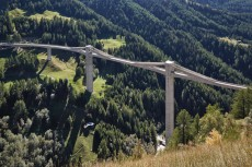 Ganter Bridge in Ried-Brig (1977–1980). This 150m-high, 678m-long structure was designed with low towers above the deck, and stiff cable stays cast into sold concrete walls [© Ralph Feiner]